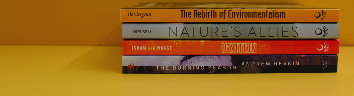 Books related to environmental activism on a shelf
