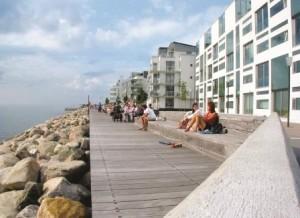 View of promenade seating and edge buildings in Bo01. (Photograph by Joakim Lloyd Raboff.)