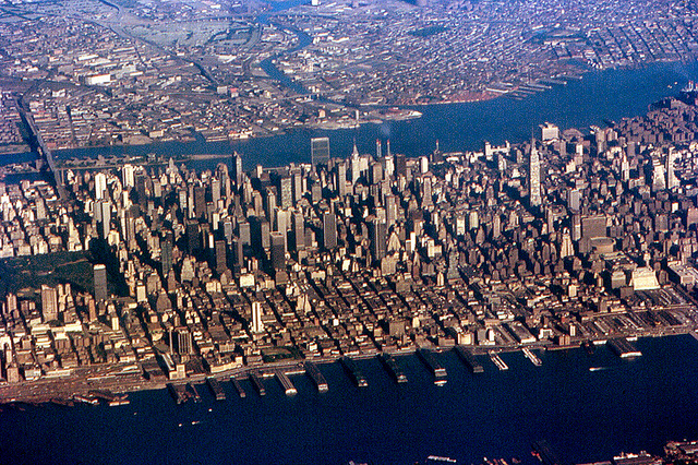 Midtown Manhattan from the air shows how closely the city and the ocean must work together. Photo by Roger Wollstadt, used under Creative Commons licensing.