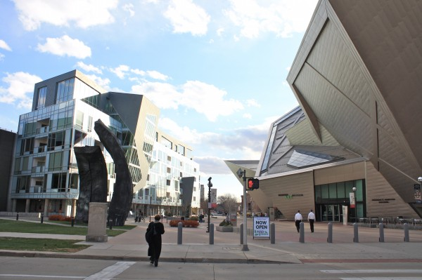 Daniel Libeskind's aggressively sculptural Denver Art Museum (right) shapes a pedestrian street with residential development by the same architect.