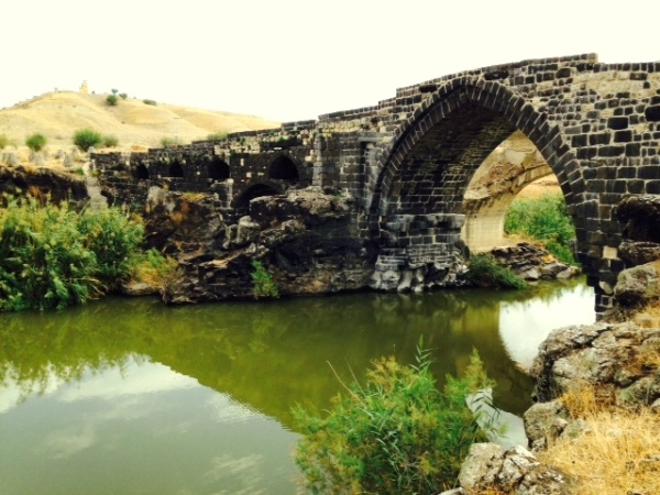 Roman bridge over the Jordan River, which forms the boundary between Israel and Jordan.