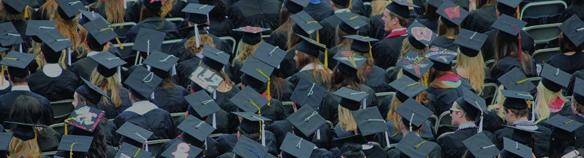 College graduates at the commencement ceremony. Photo by Good Free Photos/Unsplash