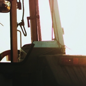 Farmer in tractor. Photo by Spencer Pugh/Unsplash