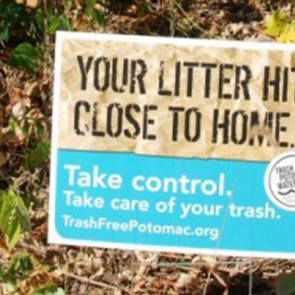 Anti litter sign in the woods. Photo by Will Schick