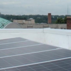 Solar panels on a city rooftop